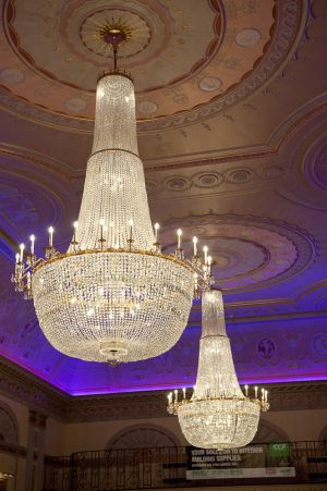 Chandeliers lit up at a gala dinner at Plaisterers Hall, London