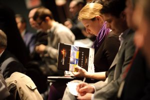 Photograph of a delegate at a trade conference